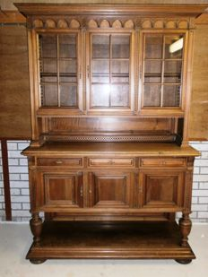 Antique sideboard with detailed wood carvings, early 20th century