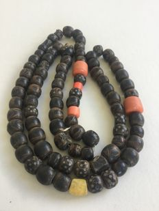 Long strand antique black coral beads with silver inlay
