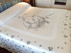 Vintage bedspread, likely made of silk, with floral decorations