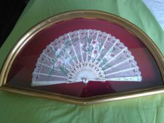 Lace hand fan painted by hand with carved bone ribs. 20th century