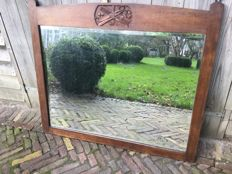 Antique barbers / hairdressers bevelled edge mirror with carved details
