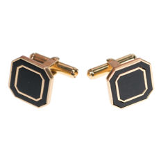 A pair of vintage cuff links featuring Onyx in 14k Gold