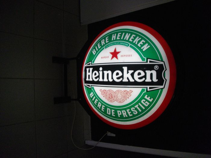 Heineken advertising sign with lighting