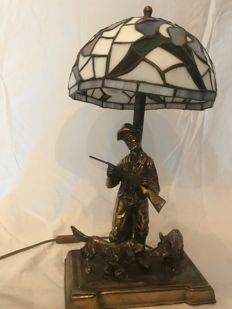 beautiful Tiffany style lamp with a copper hunting scene