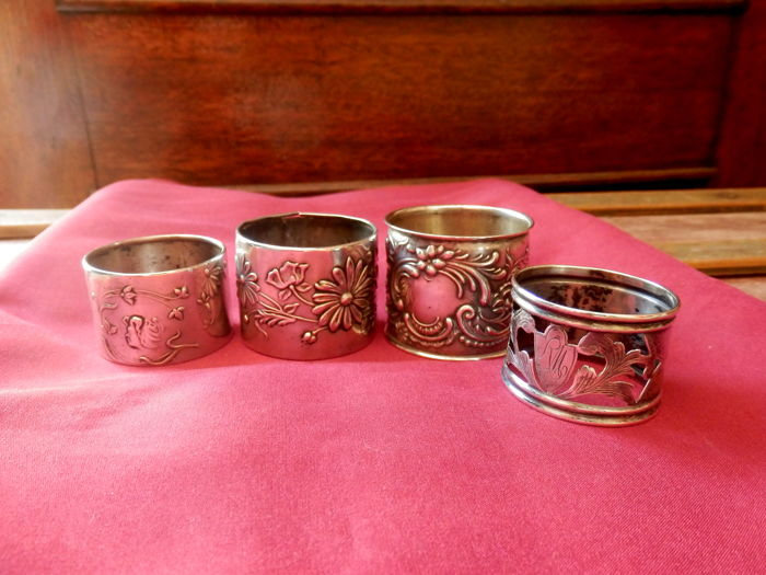 A collection of four silver napkin rings - Portugal - circa 1900