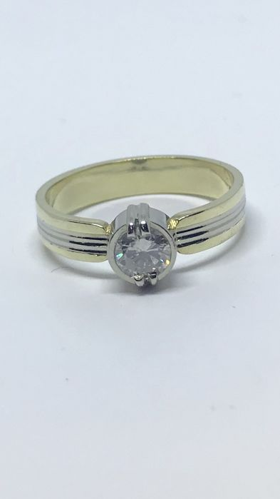 14 kt yellow/white gold solitaire ring with brilliant cut diamond, ring size: 17¾ (56)
