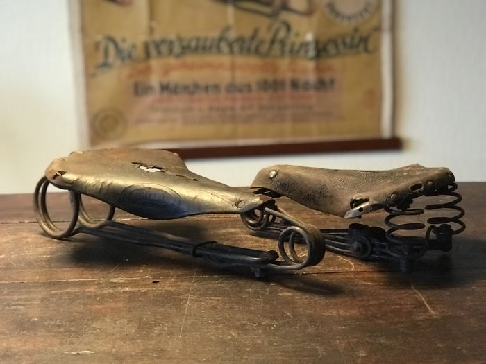 2 antique leather bicycle and motorcycle seats - museum objects