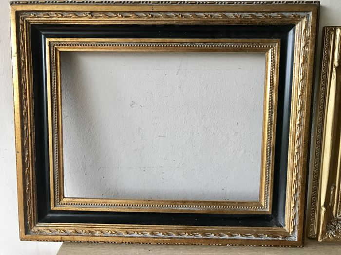 Two different large gold-plated ornament picture frames - inside ...