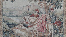 Vintage pictorial tapestry, depicting a Medieval hunting scene of noble women and Falconers on horseback, with falcons and their hounds in a landscape