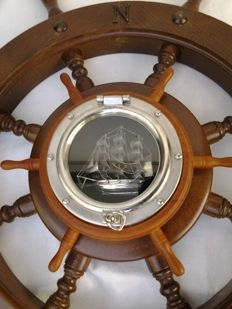 Solid, oak steering helm (sailing-/motorboat) + porthole with built-in copy of three-master bark Termophylea (?)