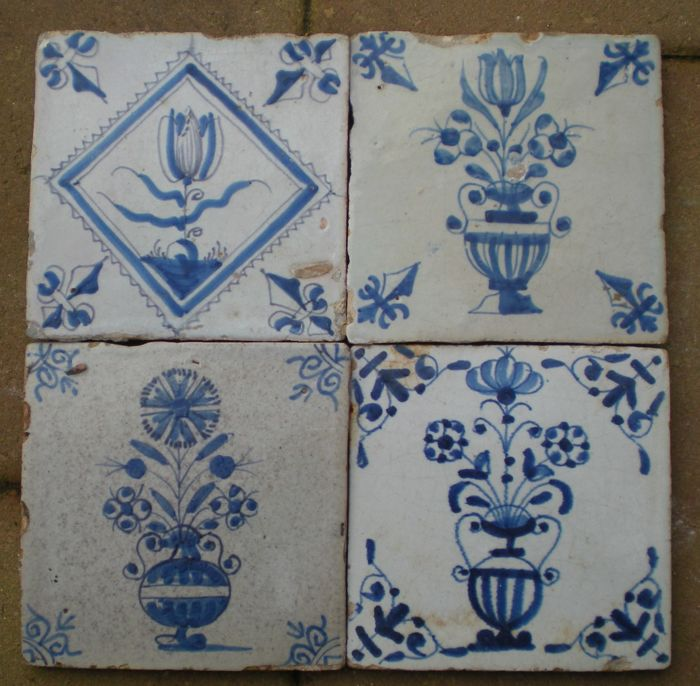 Lot with 4 antique tiles with depictions of flower pots