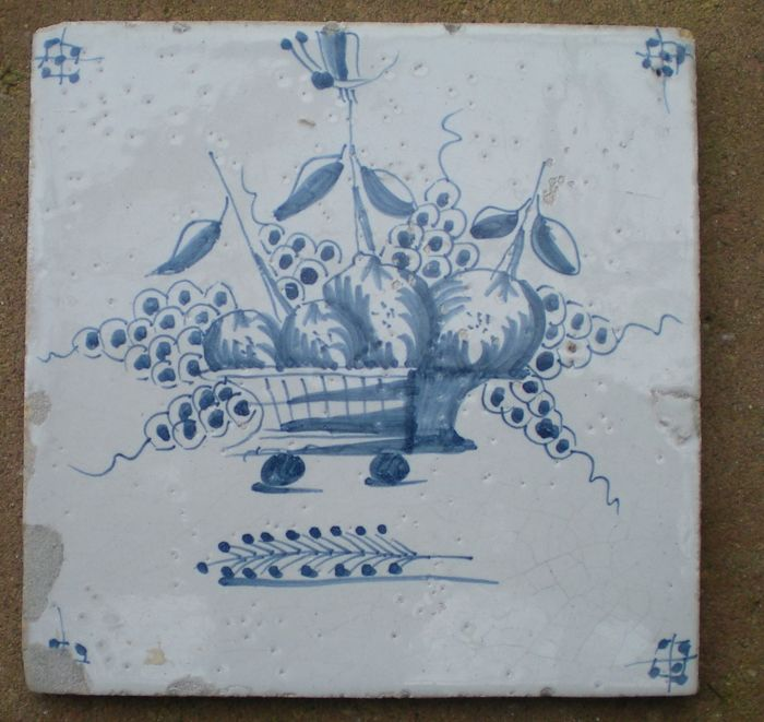 Antique tile with fruit bowl