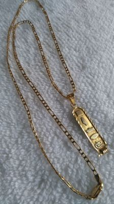 Necklace in 18 kt white gold, 60 cm long, and pendant with Egyptian markings on both sides, made of 18 kt gold and 3.5 cm long