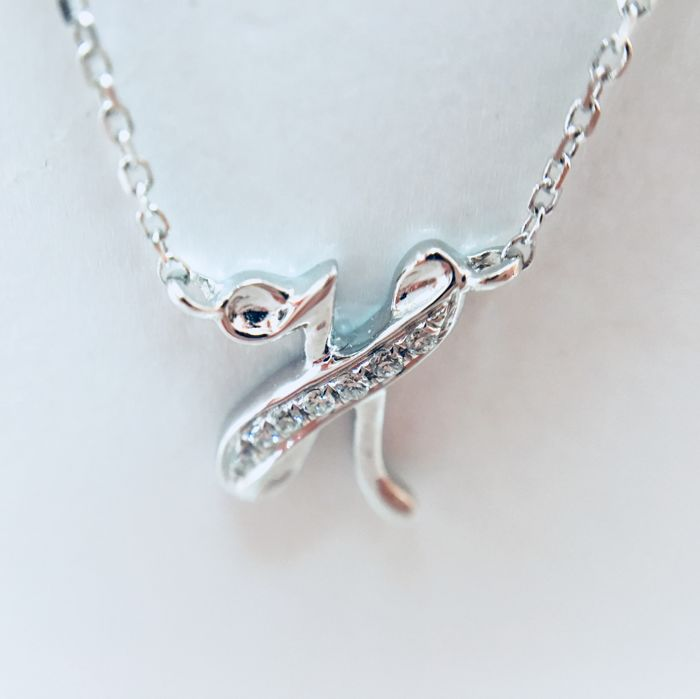 "18 kt white-gold initial necklace with a letter ""H"" set with diamonds - 0.02 ct, G/SI - length: 40 cm"