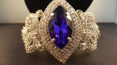 Joan Rivers statement with oval glass sapphire bracelet