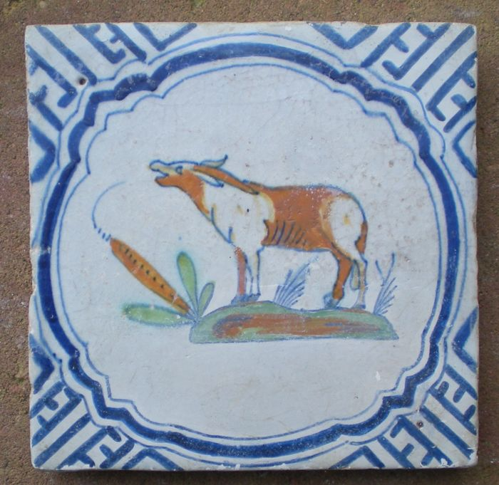 Polychrome Wan li tile with a depiction of a donkey