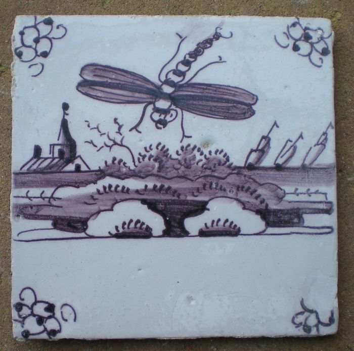 Antique tile with a depiction of an insect.  (Rare)