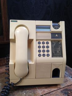 Siemens pay phone for quarters, guilders, 2.5 guilder and five guilder coins