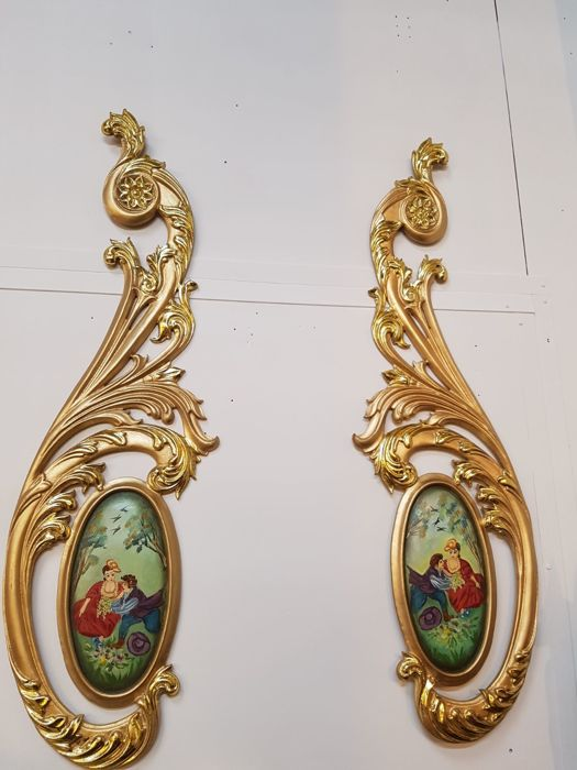 Two counterparts, oval paintings depicting gallant scenes - in solid ornamental gold plated wooden rocaille frames