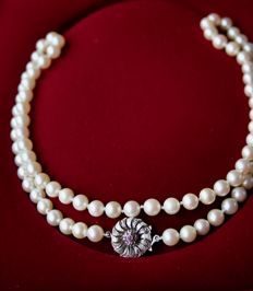 Antique long necklace with natural sea/salty water Akoya pearls from the Japanese sea. Antique 14kt. white gold clasp set with small rubies.
