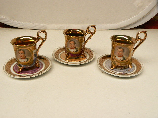Three Napoleon ornamental cups and saucers