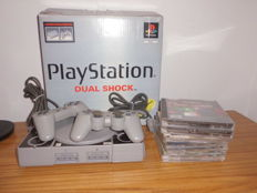 PlayStation 1 + 8 games + memory card + extra cables