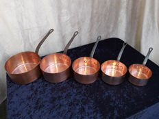 French large hand-hammered copper pans.