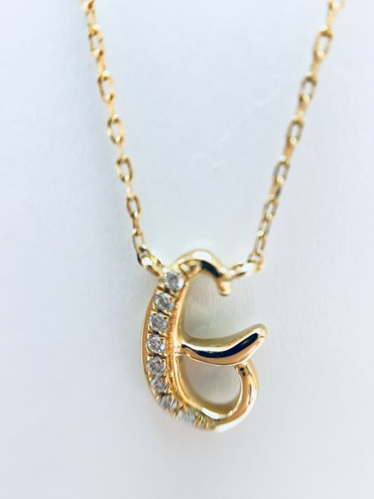 "18 kt yellow-gold initial necklace with a letter ""G"" set with diamonds - 0.02 ct, G/SI - length: 40 cm"
