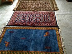 Three hand-knotted rugs from India, Baloch 150 x 90 cm, Sarough 145 x 73 cm, Gabbeh 140 x 75 cm, 2000 to present.