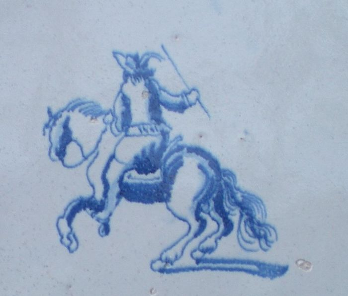 Antique tile with Horseman