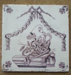 Antique tile with a depiction of a coffin (rare)
