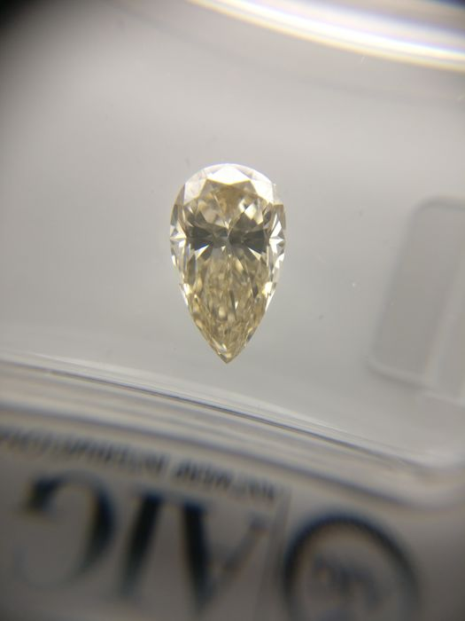 1.02 ct Pear cut diamond Fancy Light Yellowish Brown IF