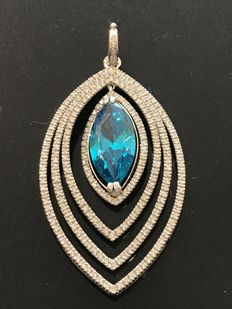 Gold pendant decorated with a synthetic blue stone surrounded by 3.60 ct of Top Wesselton diamonds