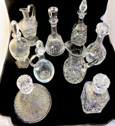 Nine pieces of cut crystal decanters and jugs, second half 20th century
