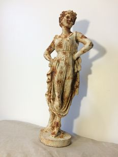 Large cast-iron garden statue of a frivolous woman