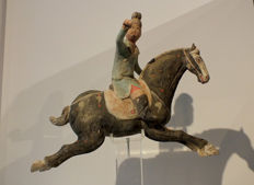 Painted Red Pottery Male Polo Player Astride a Galloping Horse (with thermoluminescence test) - Length 34 cm.