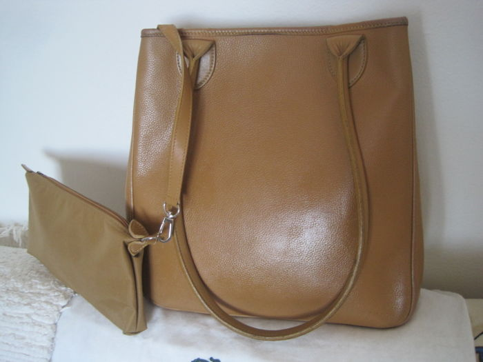 Longchamp shoulder bag, large with a separate toiletry bag.