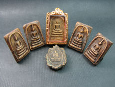 A collection of 6 Buddhist amulets - Thailand - second half of the 20th century.