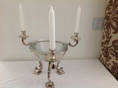 Glass hurricane lamps in silver plated holder on curled feet and with 3 candle holders.