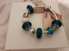Pandora heart bracelet, new with 9 charms, in .925 silver, size 17 (Italy)