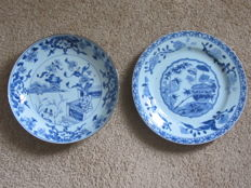 Two plates painted with a blue floral garden décor – China – 18th century