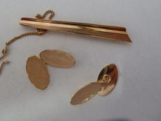 Tie clip and pair of cufflinks in 18 kt rose gold, 1960s
