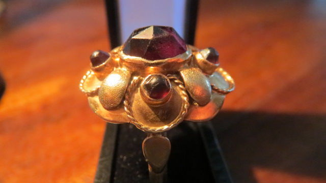 14 kt yellow gold Art nouveau ring set with large natural red wine garnets.