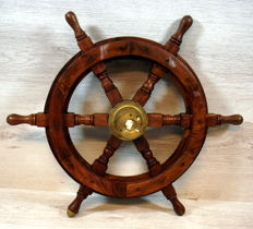 Wooden ship's helm (wheel) with built-in 'valve'