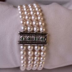 4-row bracelet with genuine very good quality Akoya round pearls AAA of Japanese sea (132 piece) and White Gold Clasp with small Emeralds.