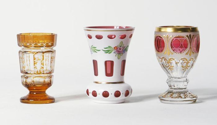 Three crystal cut and enamelled cups, Bohemia, first half 20th century