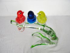 Murano - tree stump made of glass with 3 glass birds with label