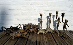 Three pewter jardinieres in Rococo style, a set of pewter candlesticks in Rococo style, set of bronze/brass candlesticks with putti (7)