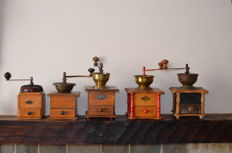Five wooden coffee grinders, mid 20th century