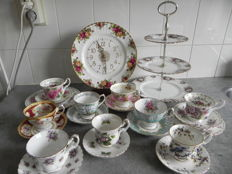 Nine Royal Albert cups and saucers, clock and whatnot